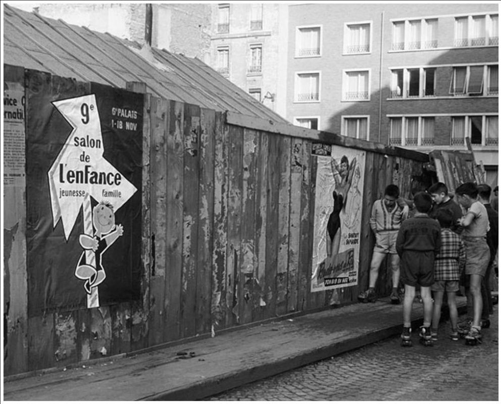 Historical photos. Boys look at a poster with a half-naked woman