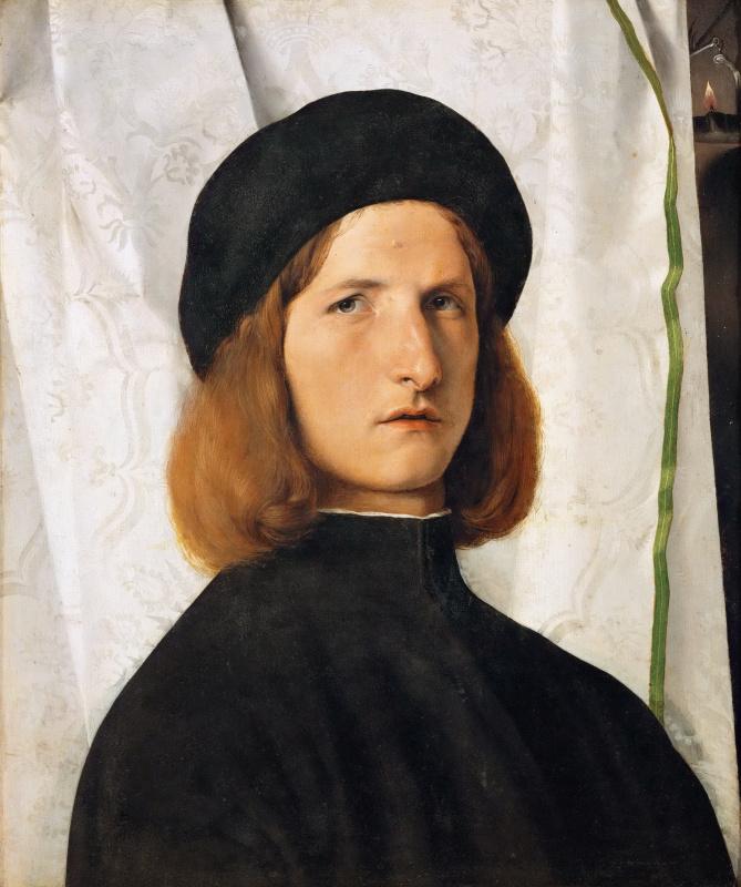 Портрет молодого человека с масляной лампой