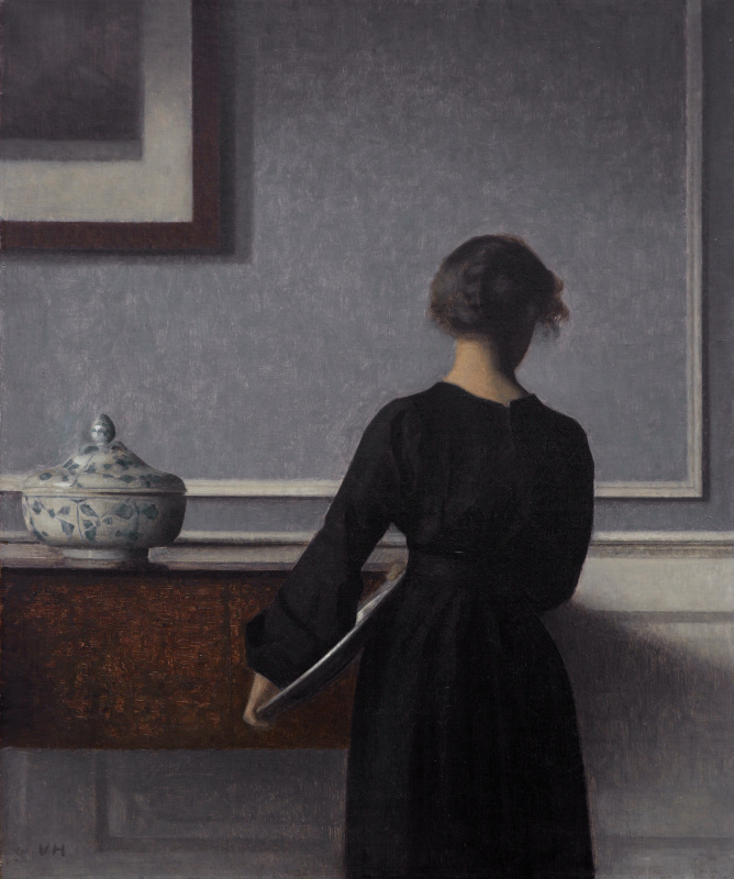 Vilhelm Hammershøi. Interior with a young woman standing back