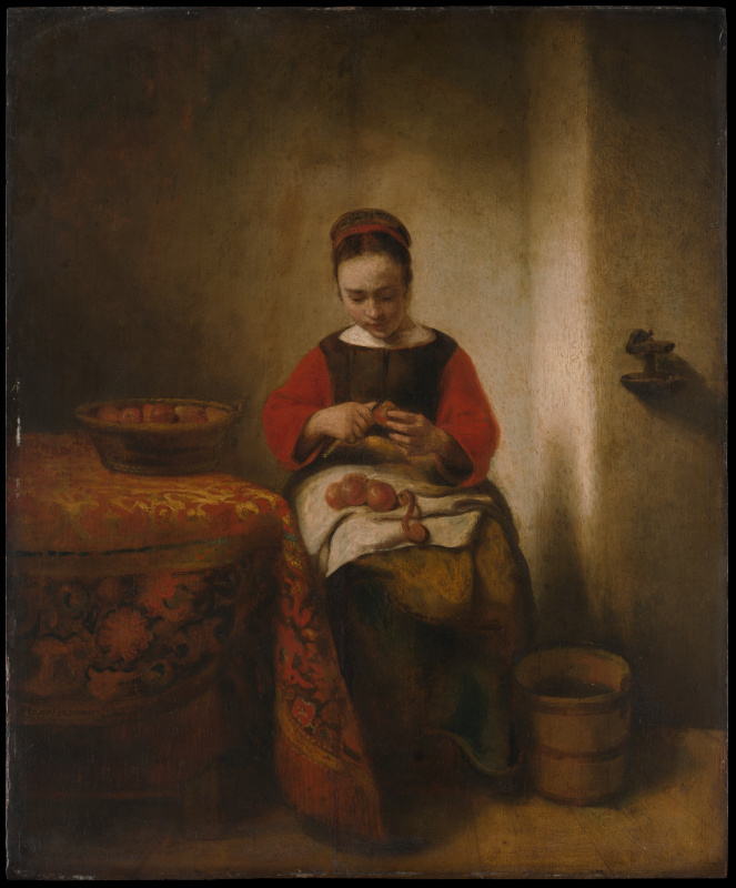 Young woman cleans the apples
