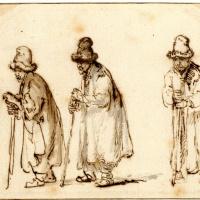 Трое мужчин в высоких меховых шапках