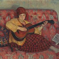 Молодая девушка с гитарой