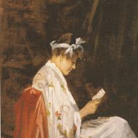 Женщина играет в карты