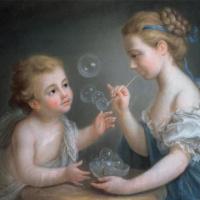 Дети, выдувающие мыльные пузыри