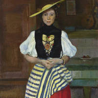 Portrait of a young woman in national costume
