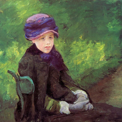 Susan seated outdoors in a purple hat