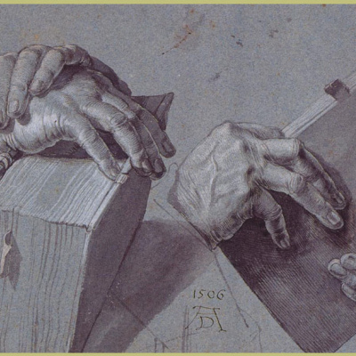 Two pairs of hands holding a book