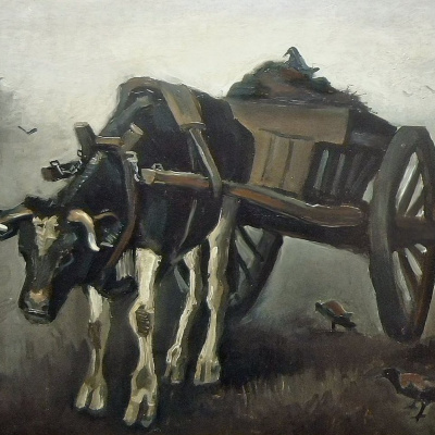 A cart drawn by a black ox