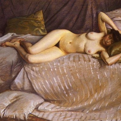 Nude woman on sofa