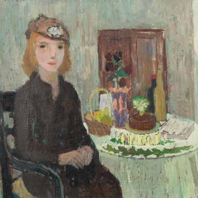 Birthday table. Portrait of a young woman in the interior