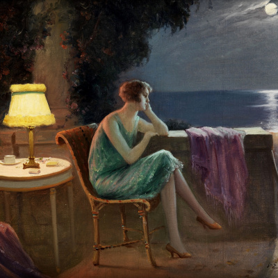 Young woman on the terrace by the sea in the moonlight.