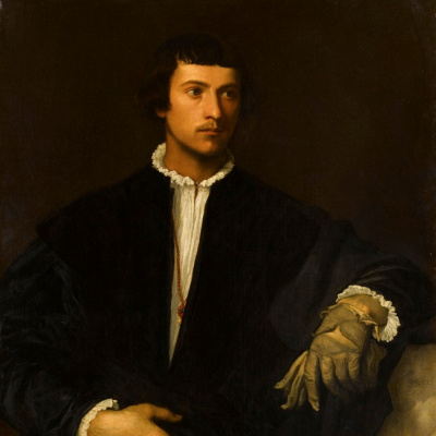 Portrait of a young man with gloves