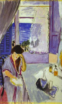 Woman reading at a dressing table