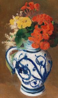 Geranium and other flowers in a ceramic vase