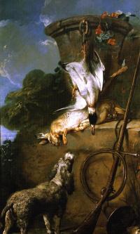 Спаниель и охотничьи трофеи